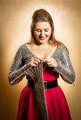 Beautiful Smiling Woman Knitting Long Scarf