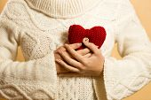 Woman Holding Red Heart At Chest