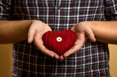 Photo Of Young Man Holding Red Knitted Heart In Hands