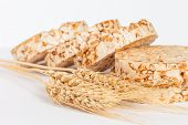 Closeup of rice cakes and wheat on white - healthy eating concept