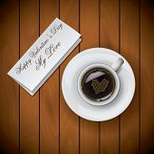 Coffee Cup With Letter On Wood Background