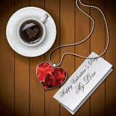 Coffee Cup With Letter With Pendant On Wood Background
