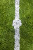 Closeup Photo Of Hands On White Start Line Drawn On Grass Of White Marking On Grass Soccer Field