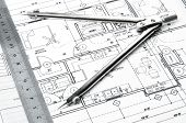 stock photo of interior sketch  - Construction blueprints planning drawings on the worktable and architectural instruments - JPG