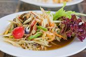 image of green papaya salad  - Thai spicy papaya salad serve with vegetables - JPG