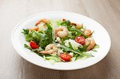 pic of rocket salad  - Fresh gourmet seafood salad with lettuce rocket and corn greens shrimps cherry tomatoes cheese served in white plate - JPG