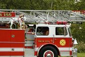 stock photo of mustering  - A fire department vehicle on display during a fire muster parade - JPG