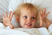 Adorable Little Girl In White Bed