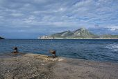 picture of elm  - Two rusty knobs on Sant Elm quay view to Dragonera Majorca - JPG
