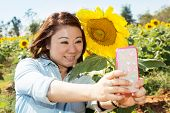 Happy Asian Woman Selfy With Sun Flower In Sunflower Flower Field.