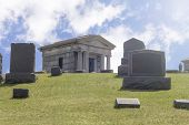 picture of graveyard  - Graveyard tombs and tomb stones on a sunny spring day - JPG