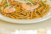 picture of chinese wok  - Authentic Chinese Shrimp lo mein noodles at a restaurant - JPG