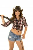 picture of cowgirl  - A cowgirl in her western wear holding on to her leather whip - JPG