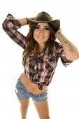 pic of cowgirl  - a cowgirl with a smile on her face with her hands on top of her hat - JPG