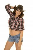 stock photo of cowgirl  - A cowgirl with a smile in her short shorts and plaid top - JPG