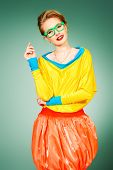 stock photo of shot glasses  - Glamorous fashion model posing in vivid colourful clothes and glasses - JPG