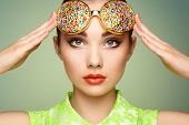 picture of jewelry  - Portrait of beautiful young woman with colored glasses - JPG