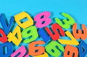 stock photo of blue things  - Plastic colored numbers on a blue background close up - JPG