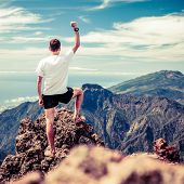 stock photo of motivational  - Trail runner man and success in mountains - JPG