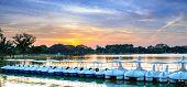 pic of paddling  - Paddle boats resting on a lake at sunset - JPG