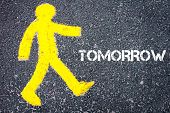 picture of pedestrians  - Yellow pedestrian figure on the road walking towards TOMORROW - JPG
