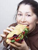 stock photo of tomato sandwich  - Woman with a sandwich with tomatoes - JPG