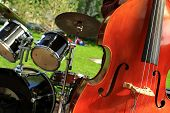 foto of double-bass  - Musical instruments double bass in the background of the drum - JPG