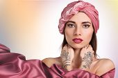 stock photo of turban  - beautiful stylish woman in oriental style in turban - JPG