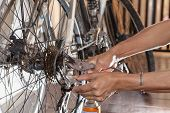 stock photo of bicycle gear  - hand diy maintenance old bicycle gear stering - JPG