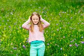 image of pullovers  - Cute little girl playing in a park - JPG