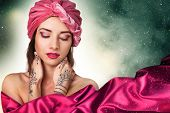 foto of turban  - beautiful stylish woman in oriental style in turban - JPG