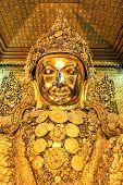 picture of buddha  - Mahamuni golden Buddha statue at Mahamuni Buddha temple in Mandalay Myanmar - JPG