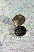foto of compass  - Geographical map and a compass - JPG