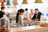 foto of cafe  - People ordering at the counter in a cafe - JPG