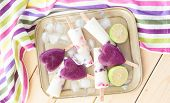 picture of popsicle  - Homemade frozen popsicles with fresh fruits and lime - JPG