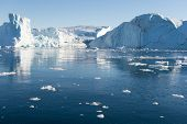picture of iceberg  - Beautiful Icebergs in Greenland with blue Sky - JPG