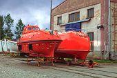 stock photo of shipyard  - A lifeboat at the shore in shipyard - JPG