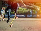 picture of skateboarding  - Silhouette skateboarder jumping in city on skateboard under the bridge - JPG