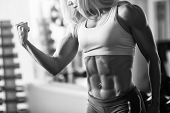 picture of muscle strain  - Black and white photo of a strong woman - JPG