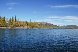 stock photo of plateau  - The river and its surroundings at the end of the summer - JPG