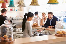 picture of cafe  - People ordering at the counter in a cafe - JPG