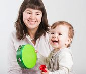 Portrait Happy Mums With A Daughter On A White Background..