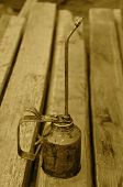 ������, ������: Long stemmed vintage oil can Sepia