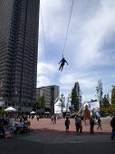 Person Ziplines Through Justin Herman Plaza