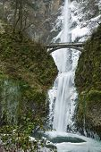 Multnomah Waterfalls frozen in winter.