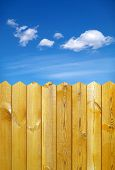 foto of wooden fence  - wooden fence and blue sky with clouds - JPG