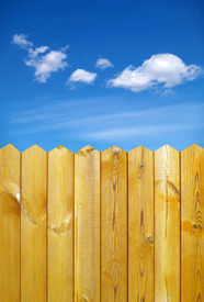 stock photo of wooden fence  - wooden fence and blue sky with clouds - JPG