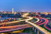 Washington, D.C. skyline with highways and monuments. poster