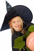 image of jack-o-laterns-jack-o-latern  - Young blond girl dresses in hallowwen witch costume - JPG