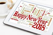 Happy New Year 2018 greetings card  - word cloud on a digital tablet with a cup of coffee poster